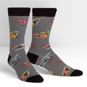 Mustaches and monocles, biplanes and bygone days. If you long for the days of propeller planes ready to whisk you away on adventures, this crew sock is for you! What barriers are you going to break wearing these socks? Sky's the limit! 59% Cotton, 39% Polyester, 2% Spandex. Made in Korea. Our threads are certified by OEKO-TEX® Standard 100, which means we leave out harmful chemicals to keep your skin safe and happy. Approximately fits men's shoe size 7-13.