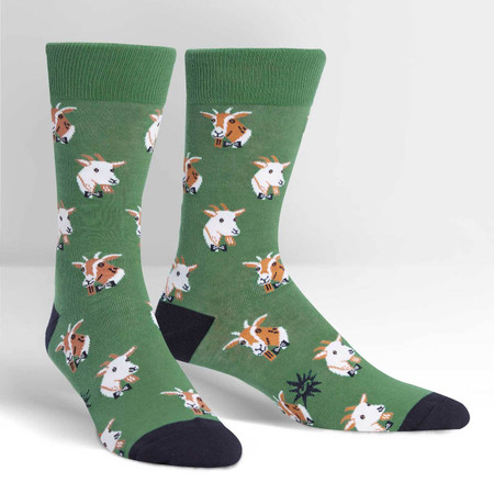 """Goats get a bad rap. Sure, they sometimes eat garbage, walk around with their tonques out, and have a """"where am I?"""" expression on their face. But they are inquisitive creatures whose curiousity often gets them in trouble. The worldly goats pictured on this men's crew sock are here to change the perception of goats. Afterall, was it not goats who first discovered coffee? Thank a goat for your next latte. 54% Cotton, 42% Polyester, 4% Spandex. Made in Korea. Our threads are certified by OEKO-TEX® Standard 100, which means we leave out harmful chemicals to keep your skin safe and happy. Approximately fits men's shoe size 7-13"""