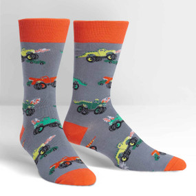 Let's be honest, this is how monster truck rallies should be. (Monster trucks not to scale.) Those tails could do a lot of damage. And instead of horn honks, the trucks could let out a mighty ROAR. Well, until our dreams come true, you can wear these on a men's crew sock. 57% Cotton, 37% Polyester, 3% Spandex, 3% Nylon. Made in Korea. Our threads are certified by OEKO-TEX® Standard 100, which means we leave out harmful chemicals to keep your skin safe and happy. Approximately fits men's shoe size 7-13