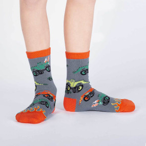 Let's be honest, this is how monster truck rallies should be. (Monster trucks not to scale.) Those tails could do a lot of damage. And instead of horn honks, the trucks could let out a mighty ROAR. Well, until our dreams come true, you can wear these kids crew sock. 70% Cotton, 25% Polyester, 4% Nylon, 1% Spandex. Made in Korea. Our threads are certified by OEKO-TEX® Standard 100, which means we leave out harmful chemicals to keep your skin safe and happy. Approximately fits children ages 7-10, shoe size 1-5.