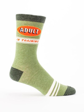 "For everyone who struggles with being an adult, just remember: don't train too hard - no one likes TOO much adult   Men's shoe size 7-12. 61% combed cotton; 36% nylon; 3% spandex.  PLEASE NOTE: This sock features panoramic art - awesome from every angle. There's no ""right and left."" The sassy phrase falls on the outside of your right leg, and the inside of your left."