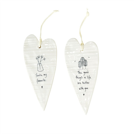 "These long hanging heart ornaments are made of porcelain, and each features a sweet phrase.  you're my favorite. the good things in life are better with you. how wonderful life is with you in the world. in a world where you can be anything, be yourself. love makes a house into a home. always remember you are loved. never give up, great things take time. families are the heart of every home. Size:  2 1/2"" x 5 1/4"""