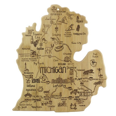 """Our Destination Cutting & Serving Boards are laser engraved with iconic points of interest, cities, historic landmarks and wonderful roadside attractions, reminding us of the places we love and the places we hope to visit. Destination Michigan measures Size: 13.25"""" x 11.75"""" x 5/8"""""""