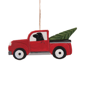 Commemorate picking out your own Christmas tree with this nostalgic ornament that features a lab in a red pickup truck with an evergreen tree in the back.   Size:  4.5in x 0.6in x 2.1in