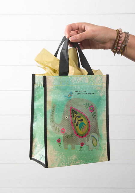 Sentiment: And So The Adventure Begins  Reusable bag features nylon webbed handles.