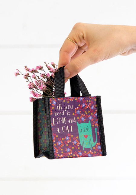 Reusable bag features nylon webbed handles and  double sided printing.  Composition: rPET, made with 80% recycled plastic water bottles Dimensions: 3.5 in L x 2.5 in W x 3.5 in H, 2 in handle drop