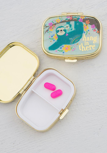 """Perfect for traveling or on-the-go, this cute little pill box features gold finish and gold foiled words """"Hang in There""""  Size: 2.25""""l x 2""""w x .75""""h."""