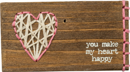 "A wooden block featuring ""You Make My Heart Happy"" sentiment and hand-stitched heart design with boxed vertical border detail. Contains strong back magnet or can free-stand alone."