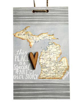 Celebrate your where a special part of your story took place with this handmade sign by Michigan artist, Katie Doucette.