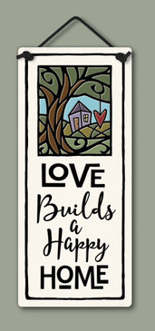 "Small tall plaque with quote, ""Love builds a happy home."" Measures 2.75"" x 6.75."""