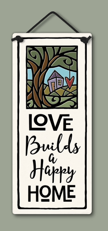"""Small tall plaque with quote, """"Love builds a happy home."""" Measures 2.75"""" x 6.75."""""""