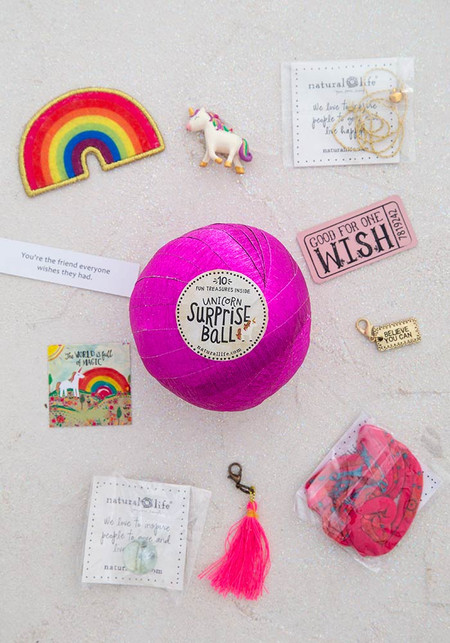 unicorn surprise ball, a fortune, 1 wish ticket, a self adhesive embroidered patch, 1 Boho Band, a sticker, a metal charm, a wishing bracelet, a crystal ball, colorful tassel charm, and a Lucky Token