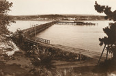 """In 1854 a jetty was constructed which  in 1875 was changed into a 630 metre causeway connecting Granite Island to the mainland. In the same year a horse drawn tram was introduced as  Victor Harbor had become a popular tourist destination.  A breakwater was built tin 1879 to increase the port's capacity. In the 1904  handbook we have the following description- """" A jetty, a mile in length, along which an iron tramway connects the mainland with Granite Island from which the causeway projects into deep water for the  accommodation of large wool and other ships, several of which are now being loaded on dispatch direct to London.""""             In the year of South Australia's centenary, 1936, Victor Harbor had 3 hotels and 36 guest houses, bowling greens, golf courses, riverboats and a cinematograph (picture theatre)."""