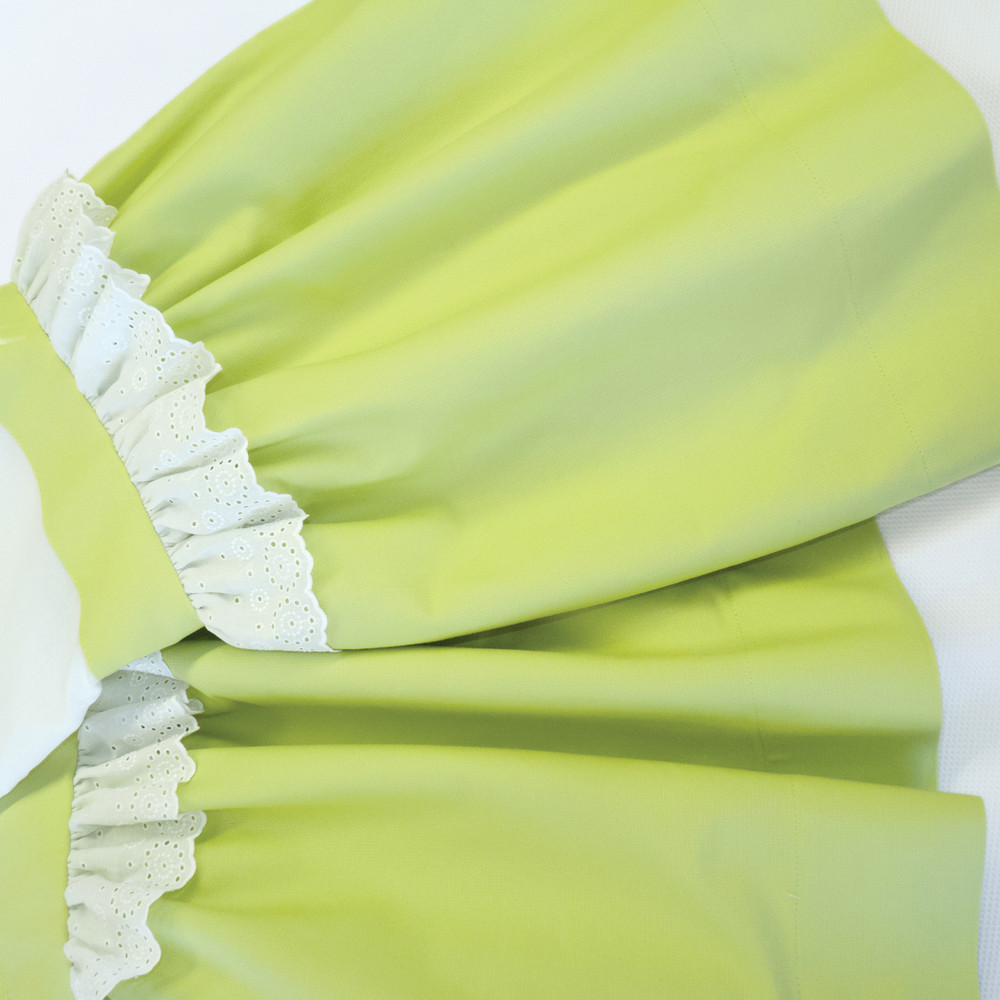 Lined & gathered Crib Skirt in chartreuse 'Lark' & 'Merry-Go-Round' embroidery