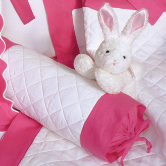 Bunny welcomes baby with custom quilted cotton & colorful linen; coverlet & neckroll pillow