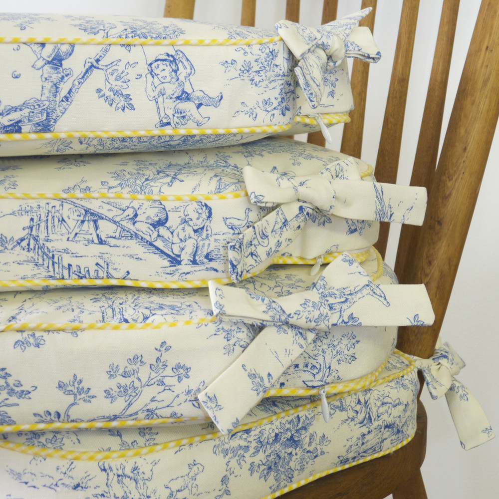 Chair cushions in wedgewood blue 'Toile' with contrasting piping & self fabric bow ties<br/>g