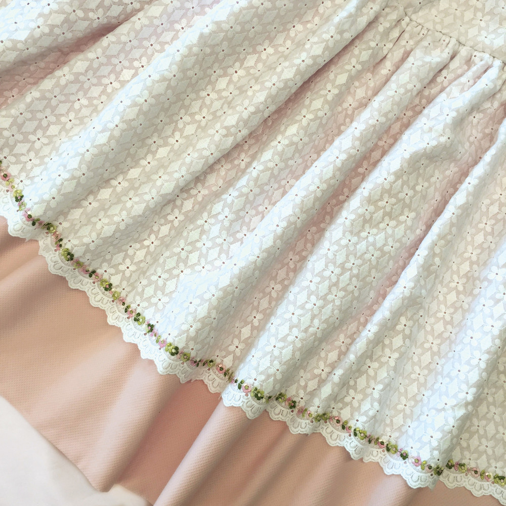 Queen Bed Skirt in peach 'Primel' with 'Alice' eyelet overlay and green, white and pink 'Flora' flowers