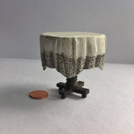 Small Table With Draped Table Cloth