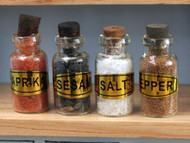 Four Filled Glass Spice Jars