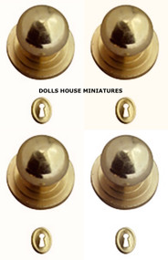 Four Gold Door Knobs With Keyholes