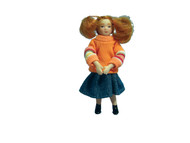 Girl Doll Wearing Orange Jumper