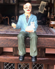 Man With Cat Sitting Figurine