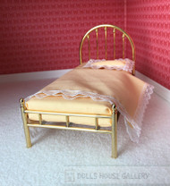 Single Golden Metal Bed With Peach Bedding