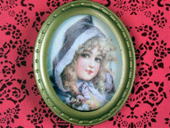 Oval Framed Picture of a Blonde Girl