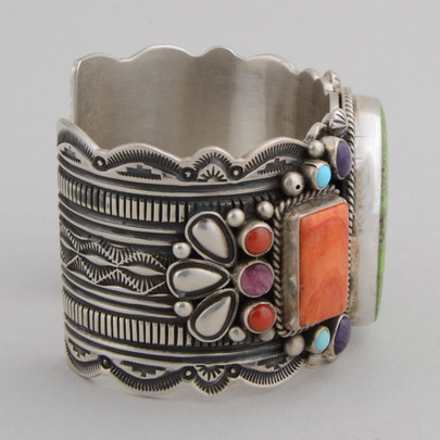 Sterling silver cuff with stamp and repousse work and multi stones.