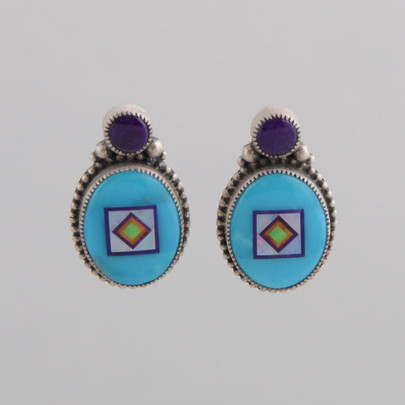 Small oval Turquoise earrings with great stone to stone inlay.