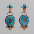 "Small Turquoise oval earrings with orange spiny oyster shell ""petals"" and coral accent.  Very nice movement makes these earrings fun!"