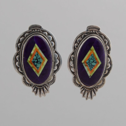 Nice Silver work frames sugilite, Orville Jack (green) Turquoise, orange spiny oyster shell and spiderweb Turquoise for a striking earring.