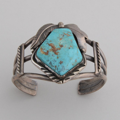 A beautiful large piece of Turquoise surrounded by wonderful Sterling Silver sets this circa 1970's sterling cuff by Julia Martinez apart from the rest!
