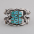 Beautiful cuff bracelet circa 1940. This cuff shows off the brilliant of vibrant Turquoise when matched with silver channeling.