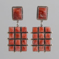 This pair of earrings by designer Federico Jimenez showcases the beauty of Spiny Oyster Shell.