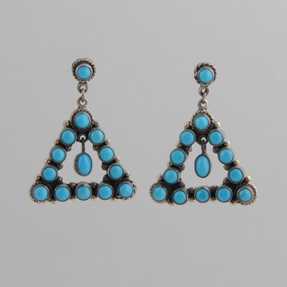 A beautiful, simple and elegant pair of Turquoise dangle earrings by Federico Jimenez.