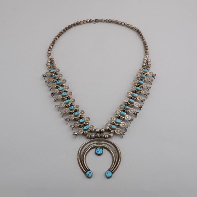 This is a very nice, elegant Box Bow Squash Blossom necklace.