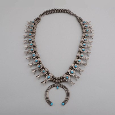 This is a very nice vintage Box Bow Squash Blossom necklace.