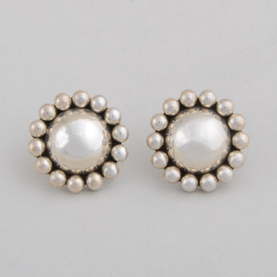 These Artie Yellowhorse Sterling Silver Earrings are circle domes surrounded by traditional sterling silver beads.