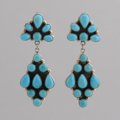 These diamond shaped clip Turquoise earrings are set in Sterling Silver.  Nice movement!