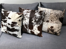 Brown cowhide pillow selection - Heifer, Vache, Holstein