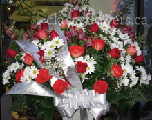 Medium size sympathy flower arrangement $85