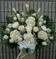 Medium size sympathy arrangement with hydrangeas and roses $105