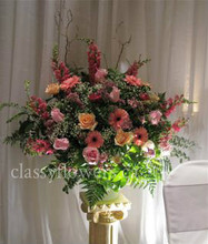Medium size sympathy flower arrangement $95