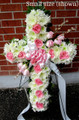 Small funeral standing cross with pink roses $75