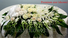 Premium closed casket spray with white flowers $190