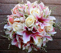 Hand Tied Bridal Bouquet With  Lilies And Pastel Roses