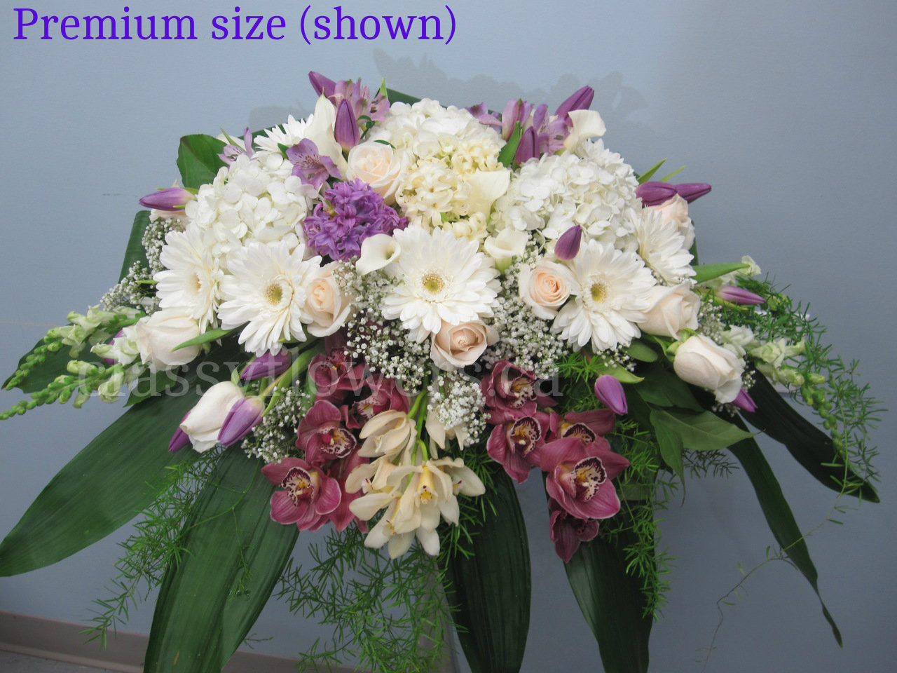White And Purple Sympathy Flower Arrangement With Orchids Classy