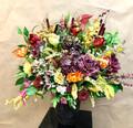 Artificial flower arrangement in a ceramic pot