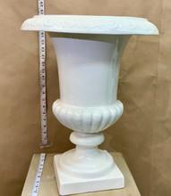 White fiferglass flower urn